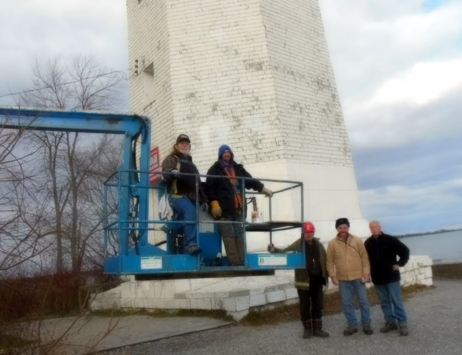 Restoration work on the Presqu'ile Point Lighthouse. Brighton, Ontario